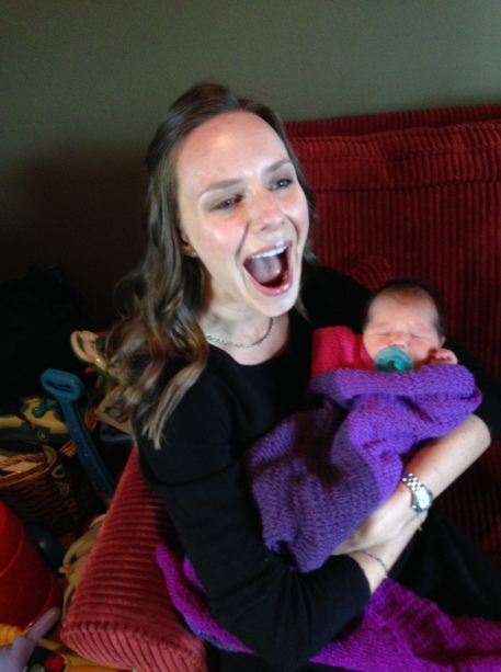 This is a horrible picture of me, but I think it captures how excited I am to be holding her for the first time. Also, check out the blanket I knit her!